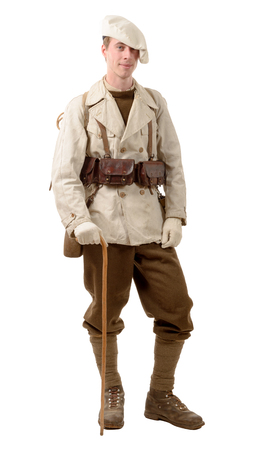 reenactment: french mountain infantry soldier during the war on white
