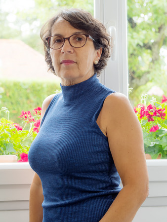 age 60: portrait of a middle-aged woman with glasses