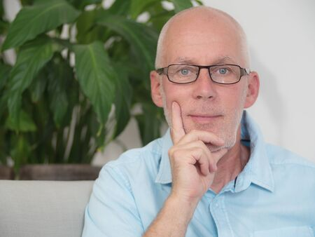 middleaged: a portrait of a middle-aged man with glasses Stock Photo