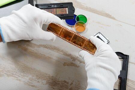 reproducing: a technician scan a negative film