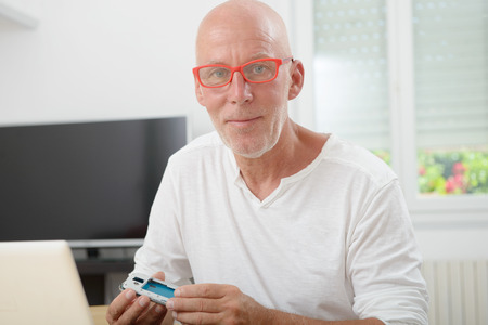repaired: man with glasses repaired a smartphone
