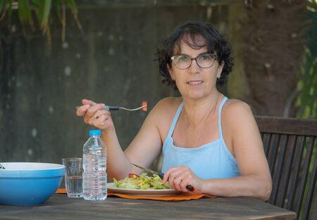 relaxen: a mature woman lunch in the garden