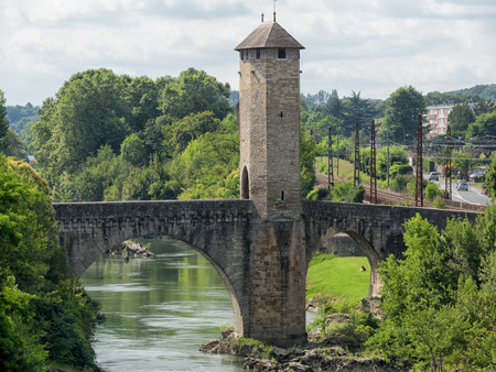 stone of destiny: Orthez old bridge in the french pyrenees Stock Photo