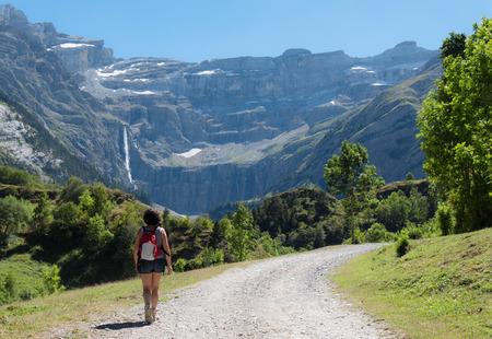cirque: A woman hiker and cirque de Gavarnie in the French pyrenees