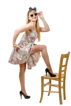 colorful dress: beautiful pinup girl with a colorful dress isolated on white background