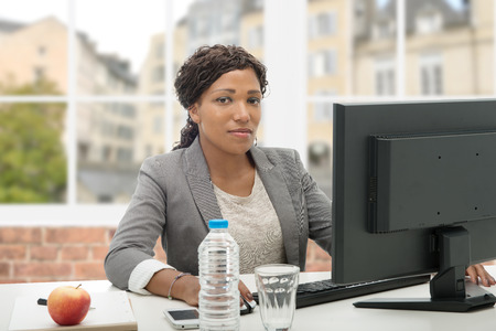 african business: beautiful african american business woman working with computer Stock Photo