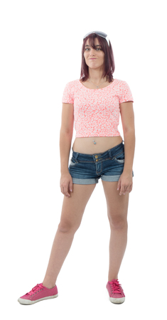 beautiful pretty young woman in pink shirt and denim shorts