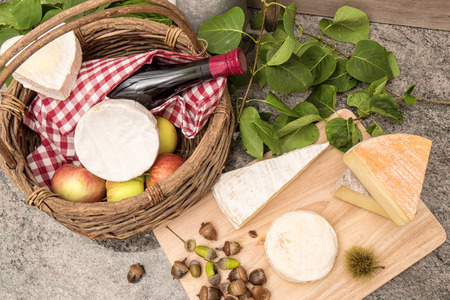 french cheeses with a glass and a bottle of wine