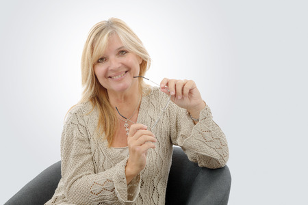 a portrait of mature smiling blond woman