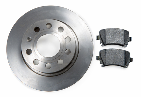 brake disc: a car brake disc and pads on white background