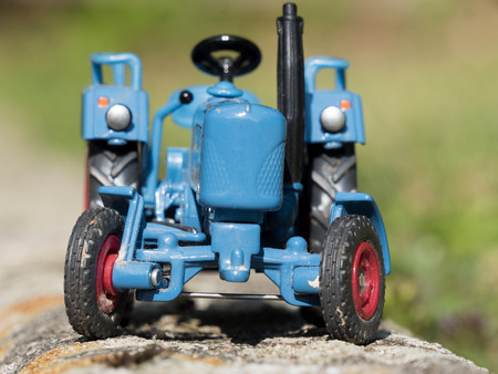 traction engine: a scale model of blue farm tractor