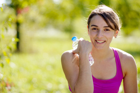 athletic girl: beautiful athletic girl drinking water after exercising Stock Photo