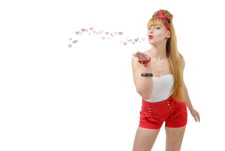 pretty pinup girl sending kisses and hearts isolated on white background Stock Photo