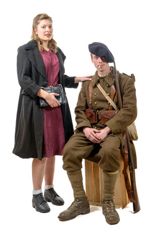 young French soldier and a young woman 1940s on white background Stock Photo