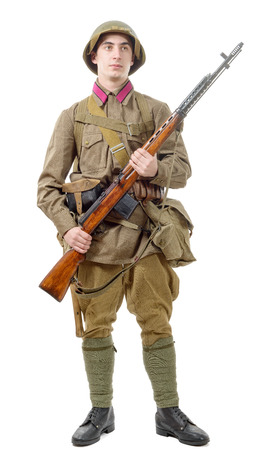 young Soviet soldier with rifle isolated on the white background