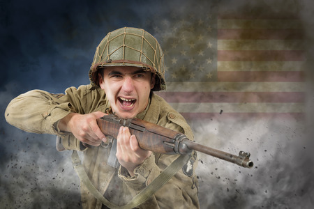 young American soldier ww2 with rifle, attack Stock Photo