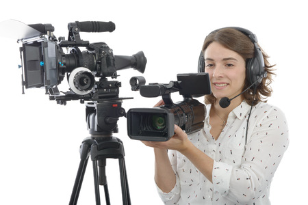 camcorder: pretty young  girl with a professional camcorder, on white