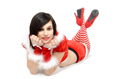 pretty sexy mother dressed as Santa on the floor Stock Photo
