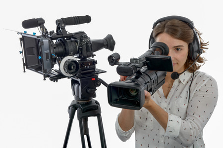 pretty young  girl with a professional camcorder, on white