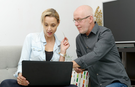 websurfing: mature couple e-shopping on internet at home