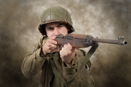 young American soldier with rifle to attack