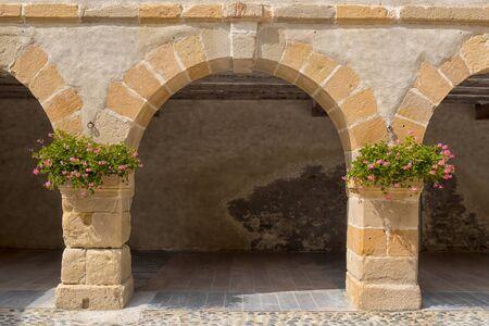Stone ark village of Navarrenx in the Pyrenees Stock Photo