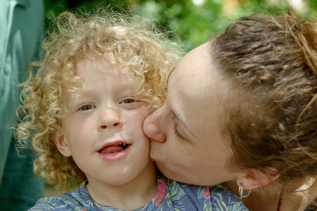 young mother kisses her little boy