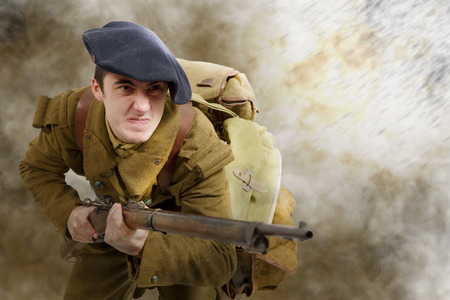 young French soldier in 1940s uniform, attacking Stock Photo