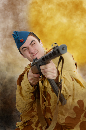 young Soviet soldier ww2 with machine gun, attack Stock Photo