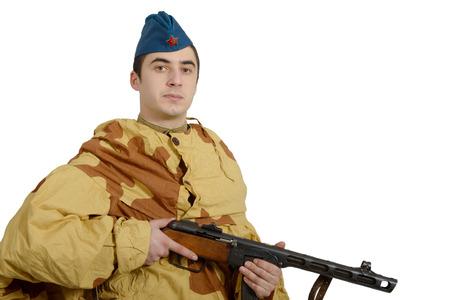 machine gun: young Soviet soldier with machine gun , ww2, on white background