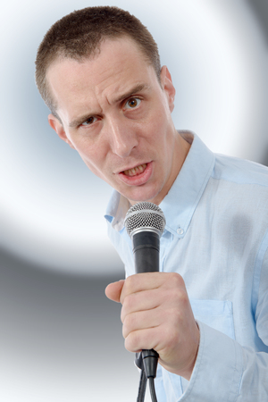an entertainer: young handsome man singing Stock Photo