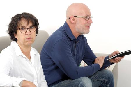 bored woman: at home, senior man watching tv and bored woman