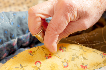 a close-up of the hands of a seamstress
