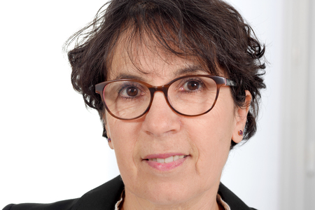 portrait of a brunette mature woman with glasses  Stock Photo