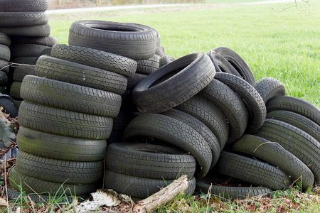 Pile of used tires in the countryside Stock Photo