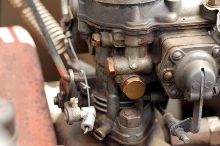 carburettor: a detail of the carburettor of an old car