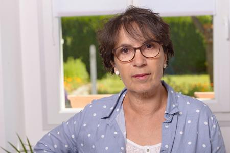Portrait of a mature brunette woman with eyeglasses