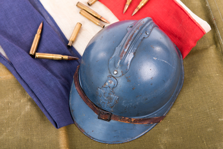 french military helmet of the First World War on a red white blue flag Stock Photo