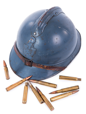french military helmet of the First World War with ammunition isolated on white background Stock Photo