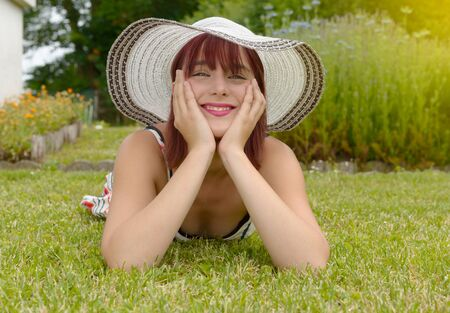 elegance fashion girls look sensuality young: a portrait of a beautiful girl with summer hat Stock Photo