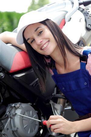 gritty: a student girl in motorbike mechanics