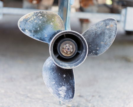 a close up of an outboard  propeller