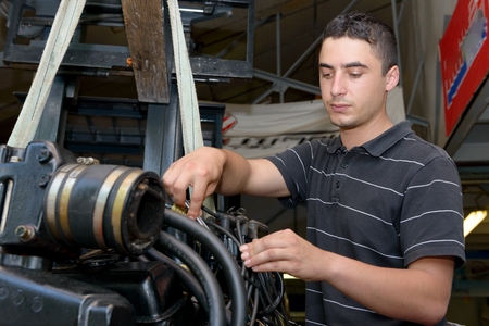 auto repair: A young man mechanic repairing  motor boats and other Stock Photo