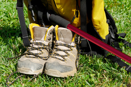 pair of hiking shoes in the grass Stock Photo