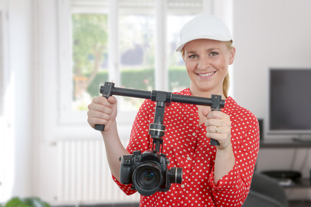 beautiful young woman videographer using steady cam Stock Photo