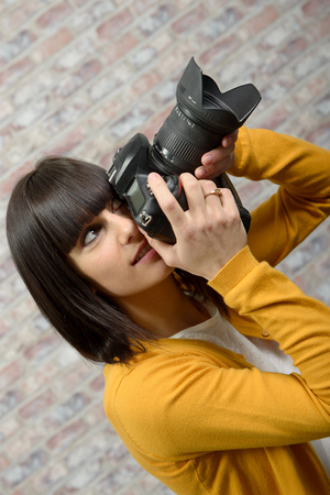 Attractive brunette woman with photo camera Stock Photo