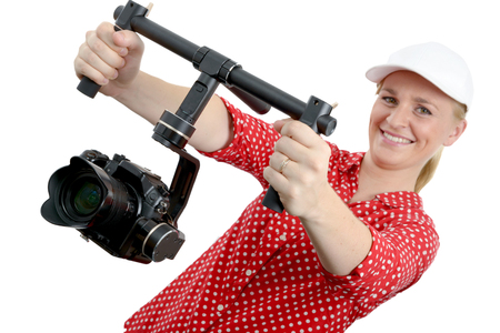 young woman videographer using steady cam,