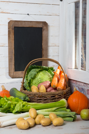 raw vegetables to cooking french  pot-au-feu with chalkboard Banque d'images