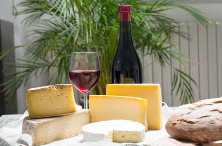 Different french cheeses with a glass of red wine Stock Photo