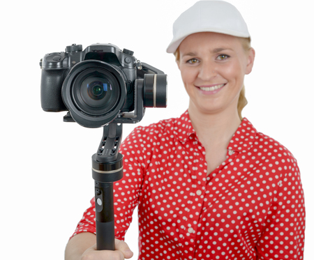 a young woman with dslr video stabilizer isolated on the white background Stock Photo